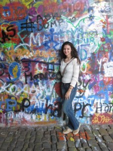 Emily in front of the Lennon Wall while studying abroad in Prague, Czech Republic.