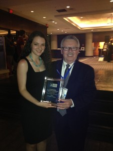 Emily with Professor Ted Clark, after the New Paltz chapter of the American Marketing Association was awarded silver at the AMA International Collegiate Conference