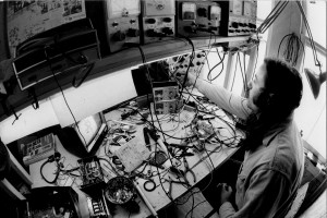 John Dominis, Chuck Kennedy at his workbench, 1973, gelatin silver print, courtesy Parry Teasdale and Carol Vontobel (Videofreex)