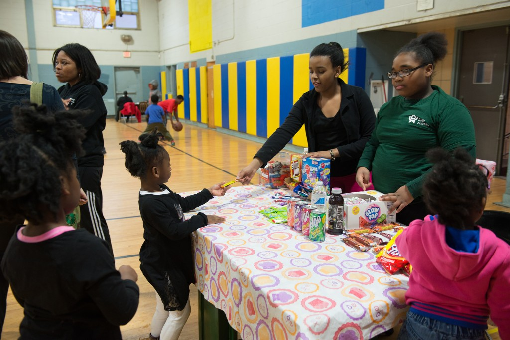 Angel Henderson (left), 12, and Loquanis Keys, 11, man the Kids' Corner snack bar at Youth Night, which helps them sharpen their entrepreneurial and customer service skills.