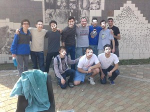 """Evan and his fraternity brothers hosting the annual """"Pie a Pi"""" fundraiser on campus."""