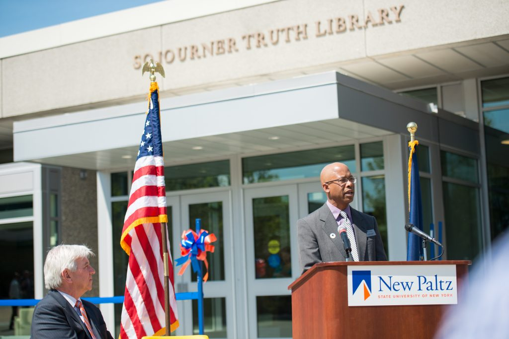Sojourner Truth Library Dean Mark Colvson speaks as State Assemblymember Kevin Cahill '77 looks on