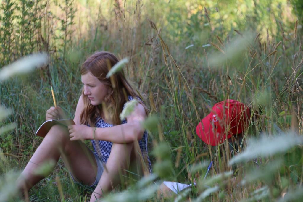 HUG_girl writing in gardens 1