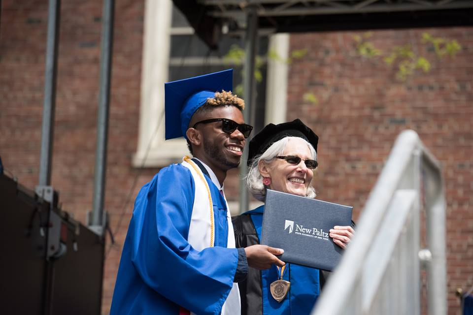 Xavier receiving his diploma with Professor Stella Deen at the 2016 undergraduate commencement ceremony