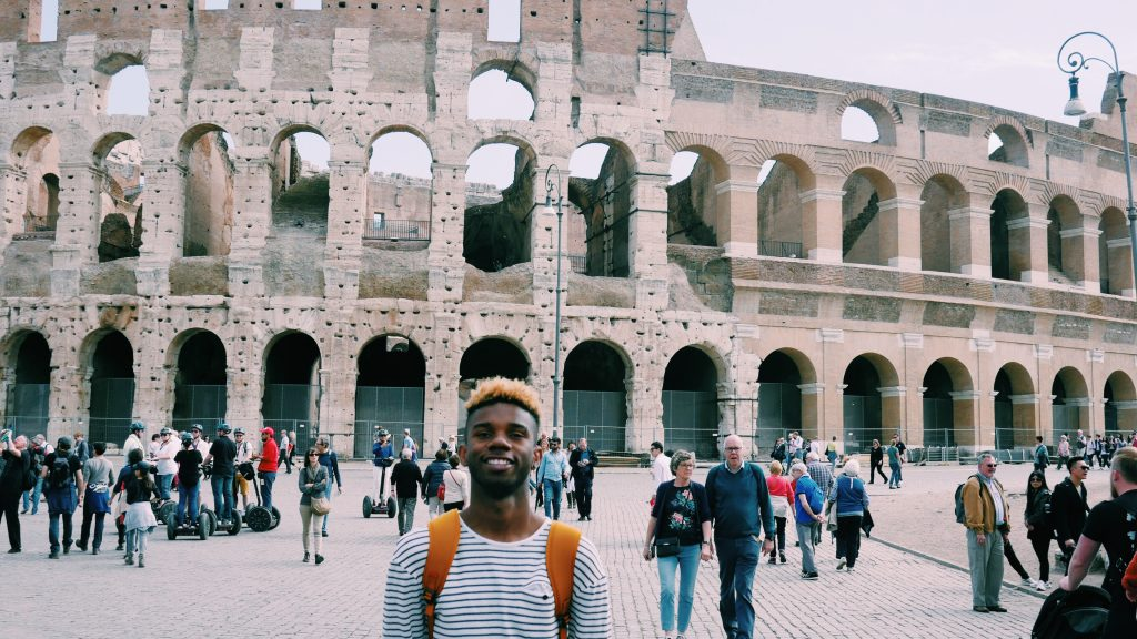 Xavier in front of the Colosseum in Rome, Italy